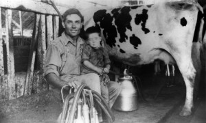 Miro Curti & son, Italo, with their first milking machine. 1924