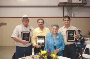 Phillip, Ken, Lilia Curti Giacomazzi, & Ben Curti were honored for their work.